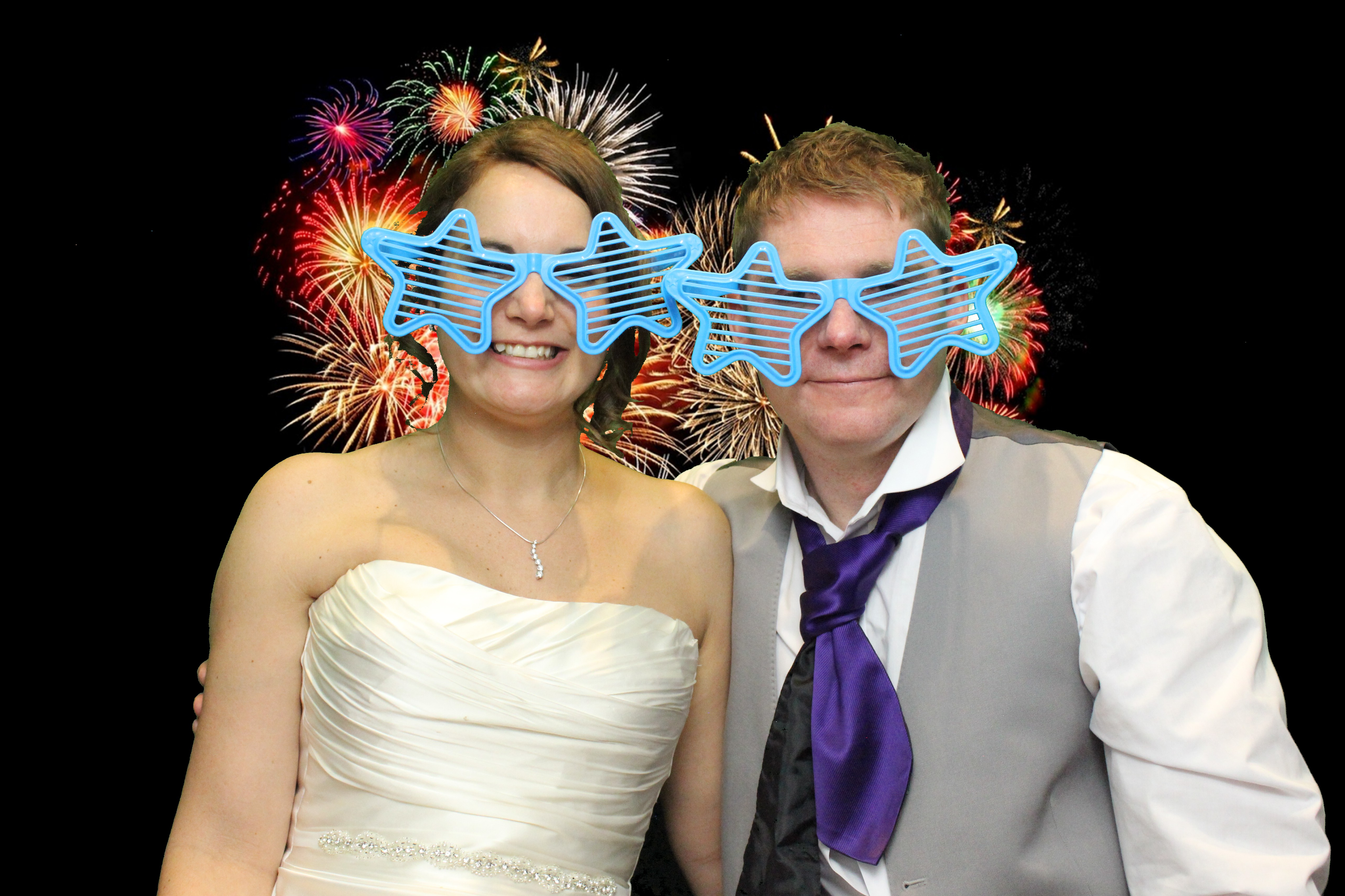 Bride and groom in our photo booth with silly glasses!