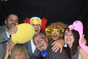 Some guests with some props - including a flamingo!  Bride and groom with a parrot - Horsham photo booth hire