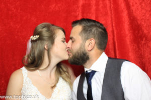 The bride and groom enjoying a moment in our photo booth - Gray manor photo booth hire