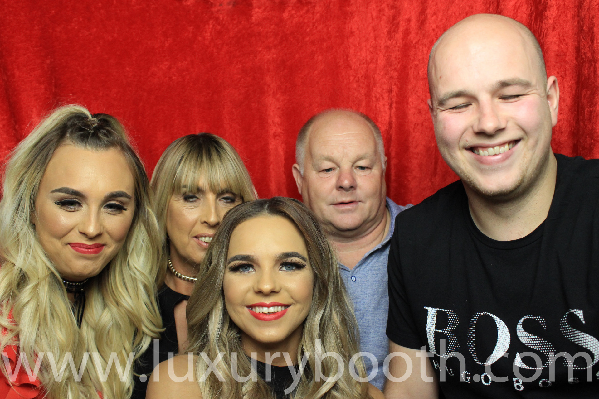 Family in the photo booth with the birthday girl in the front