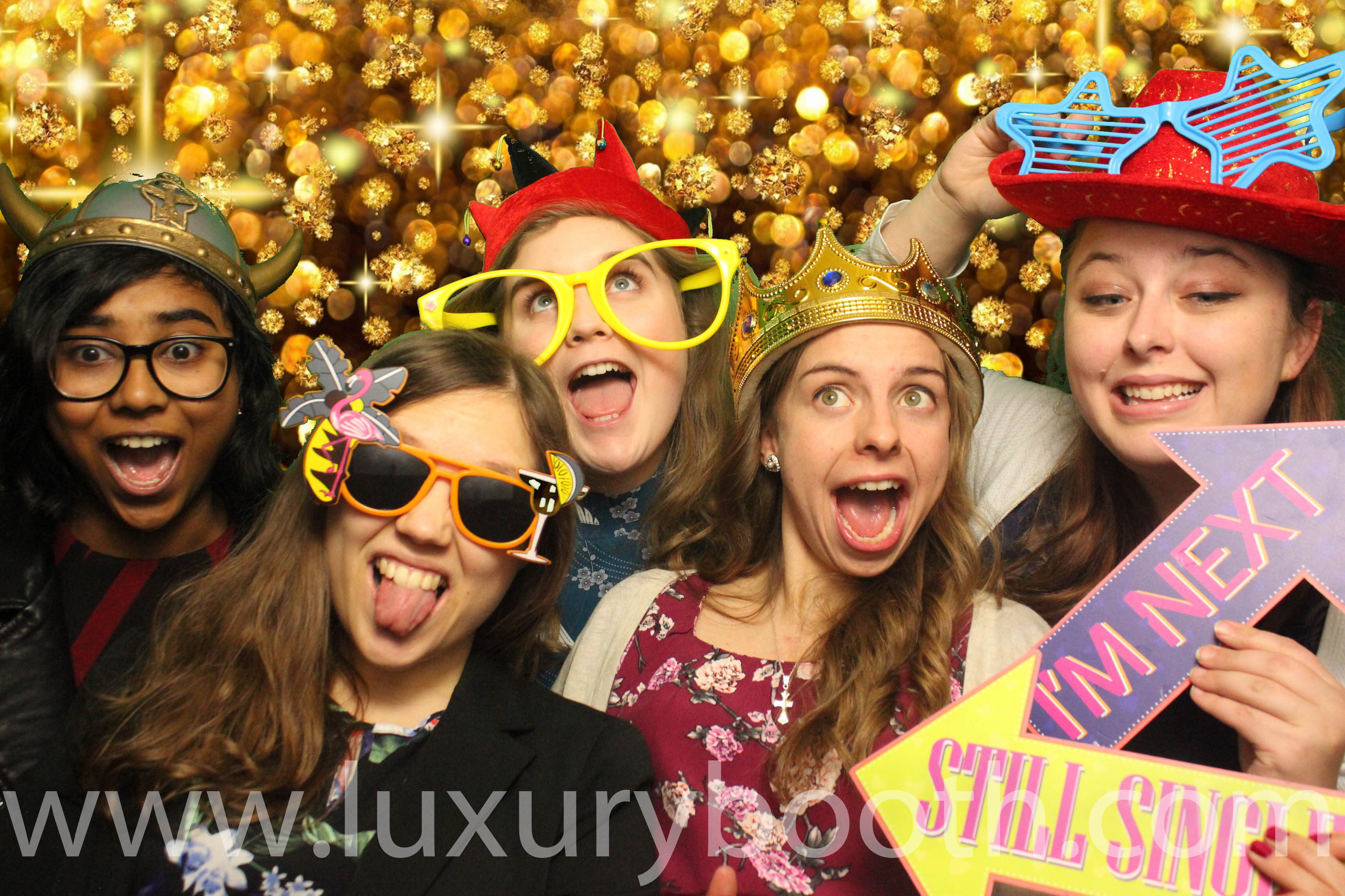 Guests in a green screen photo booth with signs - Kingston Maurward photo booth hire