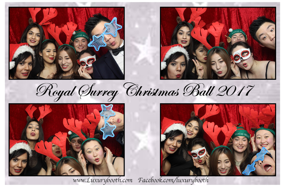 Loads of guests in a photo booth with a red background