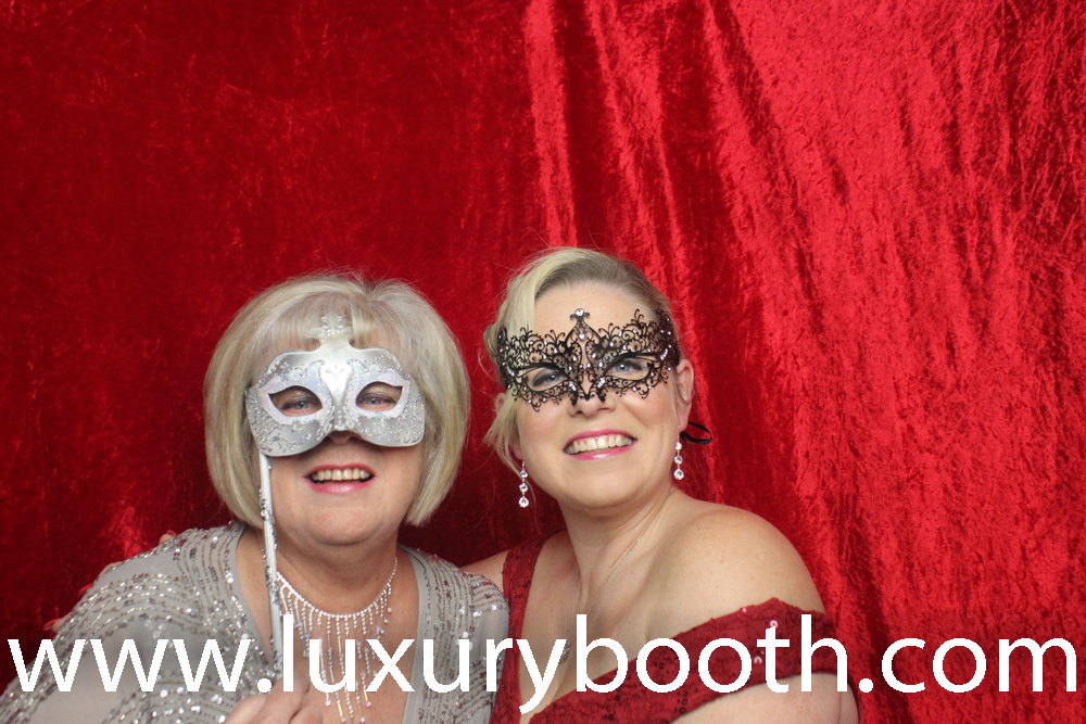 Birthday girl and her mother in our photo booth with masks