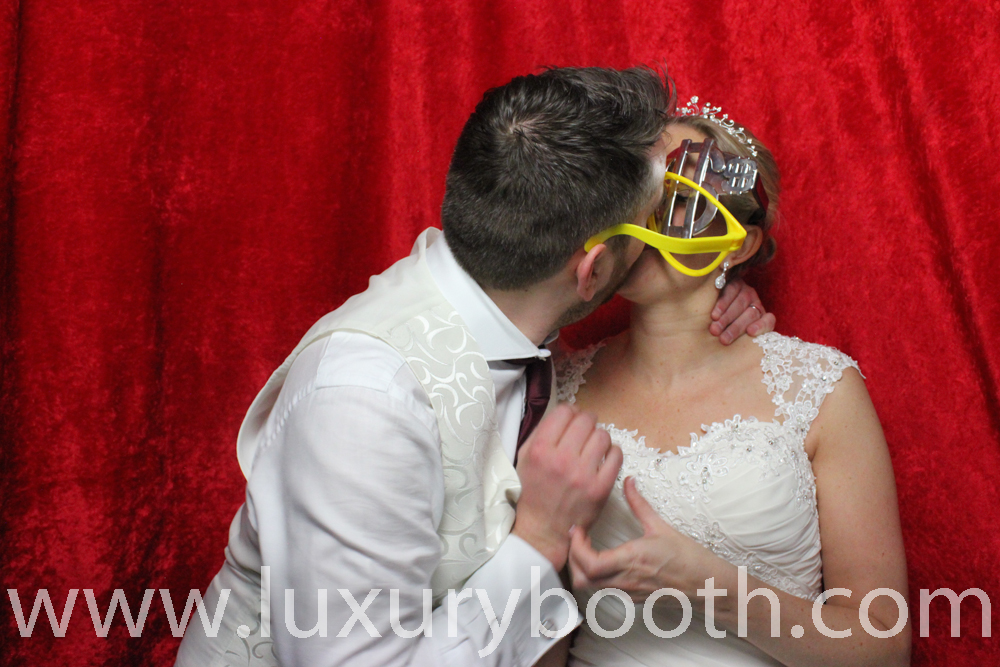 Kissing couple in a photo booth