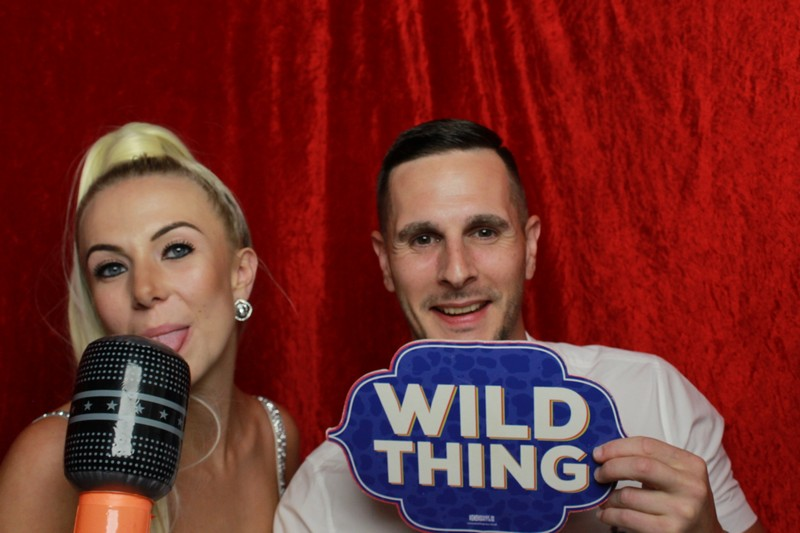 Couple in the traditional photo booth - wild thing and microphone