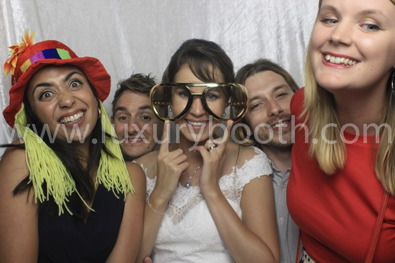 Guests in the photo booth with a white background