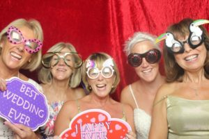 The bride and her besties in the photo booth