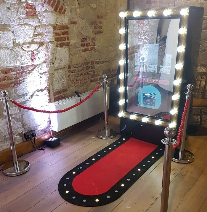 Our mirror booth with s red carpet