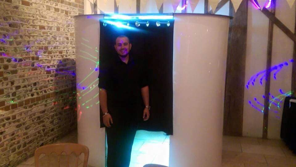 Our photo booth with white surround and butler