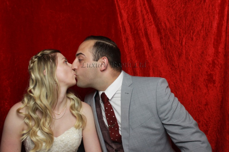 The bride and groom kissing in our photo booth