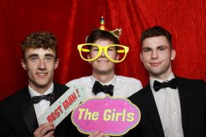 3 students at a proms and Leavers' parties - with a few signs and props.