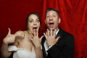 The bride and groom celebrating in our photo booth during their wedding reception at Grittleton House.