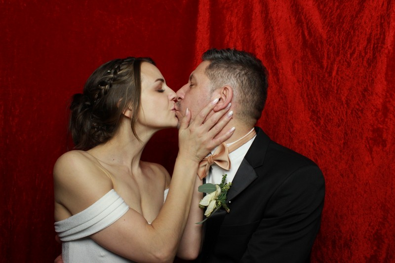 Kissing bride and groom in our photo booth during their wedding reception at Grittleton House
